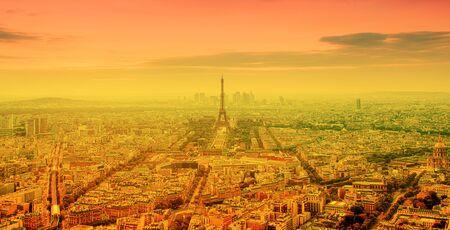 eiffel tower and bright sun on orange - heat wave in Paris, France