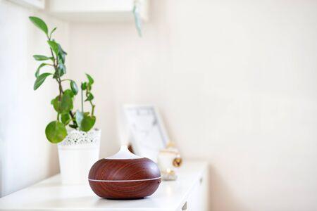 aroma oil diffuser on table at home. Air freshener Reklamní fotografie