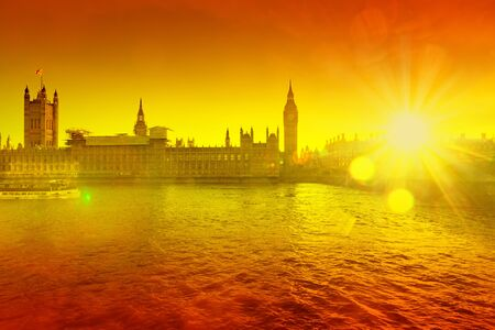 big ben against orange sunny background - heat wave in the UK