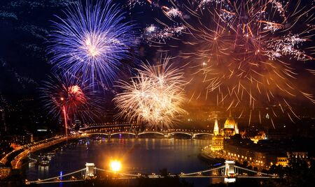 winter holiday destination Budapest fireworks over Hungarian parliament - New Year in the city Banco de Imagens