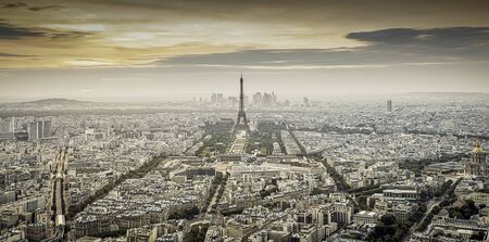aerial view over Paris at sunset with iconic Eiffel tower