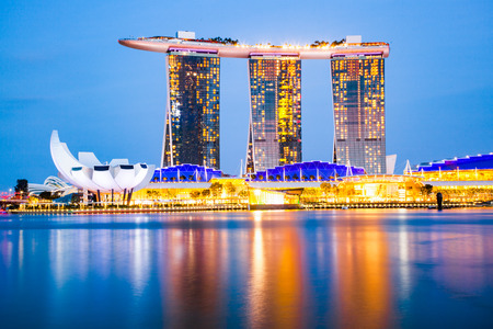 SINGAPORE, SINGAPORE - MARCH 2019: Skyline of Singapore Marina Bay at night with Marina Bay sands, Art Science museum and tourist boats