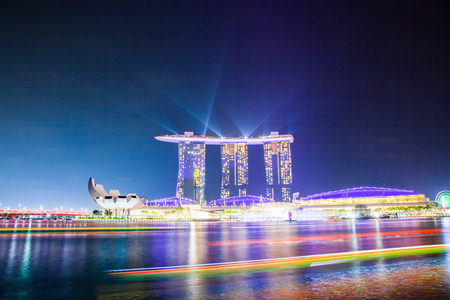 SINGAPORE, SINGAPORE - MARCH 2019: Skyline of Singapore Marina Bay at night during light show over  Marina Bay sands