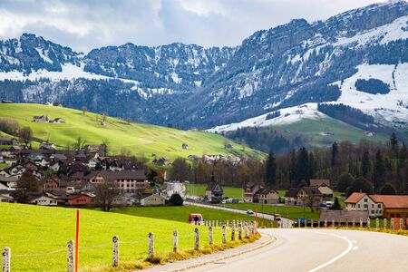 small mountain village and snowy Alps Switzerland