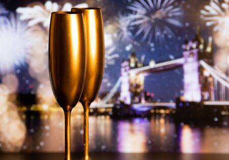 champagne glasses and fireworks  new year in London