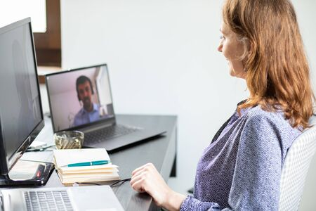 businesswoman and business in an online meeting home office