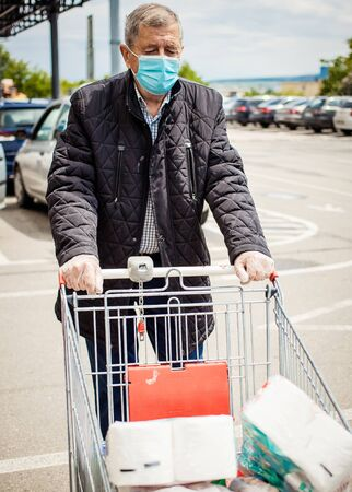 senior man shopping wearing medical mask covid prevention