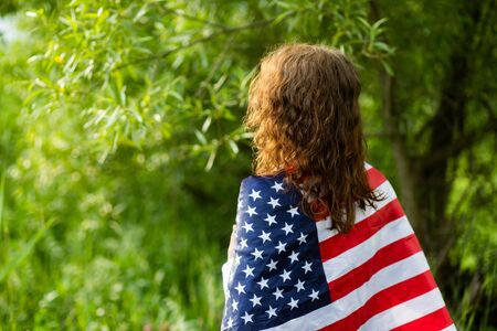 woman holding US flag independence day