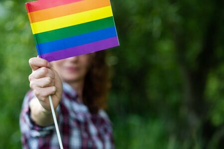 woman holding rainbow flag LGBT rights
