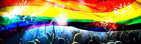 silhouette of a parade of gays and lesbians with a rainbow flag - symbol of love and tolerance