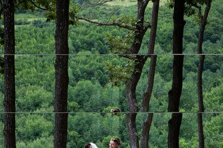 woman trekking with a dog 免版税图像