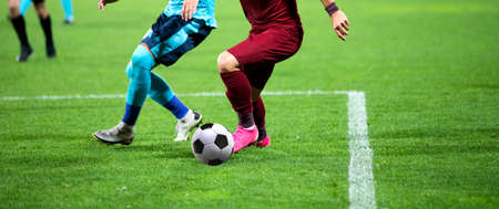 soccer game background player kicking football