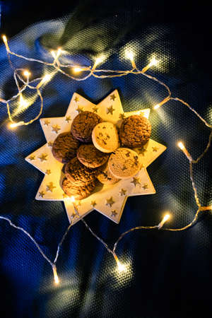 cozy Christmas at home  cookies and lights in bed