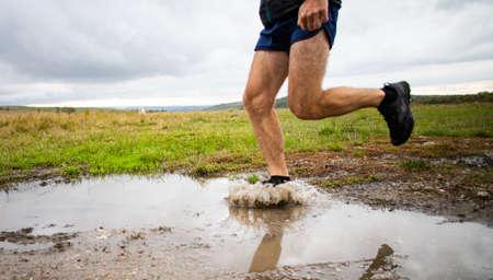 feet of trail runner running in nature Archivio Fotografico