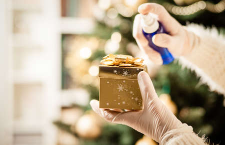 disinfecting a christmas gift box coronavirus prevention Reklamní fotografie