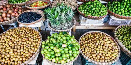 tropical spices and fruits sold at a local market in Hanoi (Vietnam) Reklamní fotografie