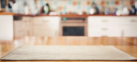 blurred kitchen interior with napkin on table