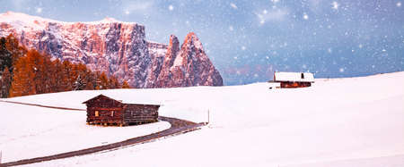 amazing winter landscape at sunrise in Alpe di Siusi. Dolomites  Italy - winter holidays destination Reklamní fotografie