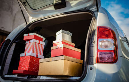 pile of Christmas gift boxes in car