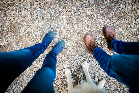 top view of couple feet and their dog
