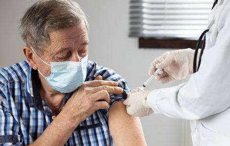 elderly man getting coronavirus vaccine