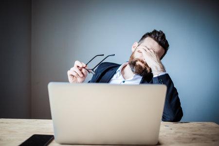 tired businessman touching his eyes bad eyesight, exhaustion Stock fotó