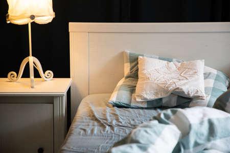 cozy bedroom detail with night lamp Foto de archivo