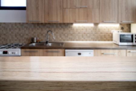 blurred kitchen interior and desk space Foto de archivo