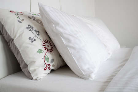 clean white pillows on bed