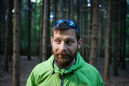 funny man portrait in summer forest Foto de archivo