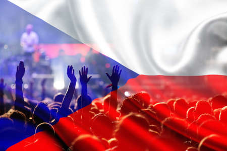 football fans supporting Czech Republic - crowd celebrating in stadium with raised hands against Czech Republic flag