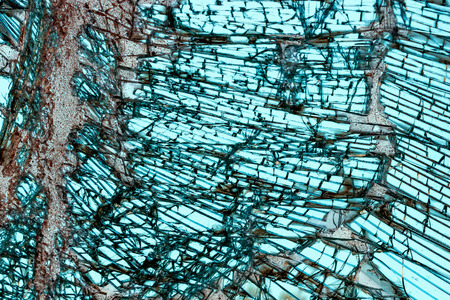 triplex: Broken car windshield made of laminated glass. Texture. Background. Stock Photo