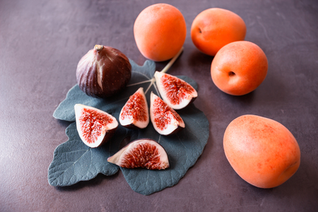 Fresh ripe figs. Juicy apricots. Concept - healthy eating, vegetarianism.