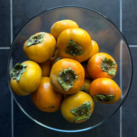 Ripe persimmon . Concept -  healthy eating, vegetarianism.