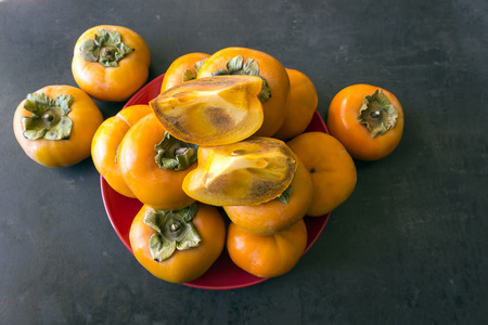 Ripe persimmon . Concept -  healthy eating, vegetarianism. Selective focus.