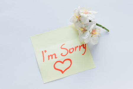 Handwritten note - I'm Sorry. Small delicate white flowers of almonds.
