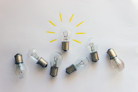 Light bulb with rays  on a white background. Concept-  idea, innovation, business concept, creativity inspiration.  Stock Photo