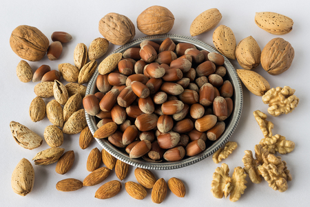 Different types of nuts . A full source of vegetable protein in vegetarianism and raw food. Assorted walnuts, almonds and hazelnuts. Concept - healthy eating.
