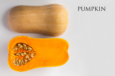Pumpkin halved on white background with copy space. Butternut squash. Concept - organic food, vegetarianism, healthy food. Text.