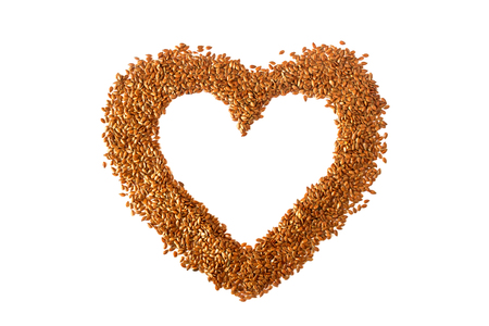 Sign  heart lined with flax seeds. Concept- healthy diet, cancer prevention, vegetarianism, raw food diet. Stockfoto