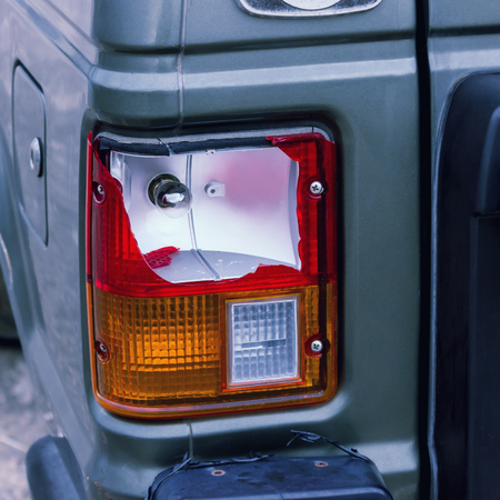The rear lamp of the silver car broken by the accident. Concepts- accident, car insurance, traffic accident. 写真素材