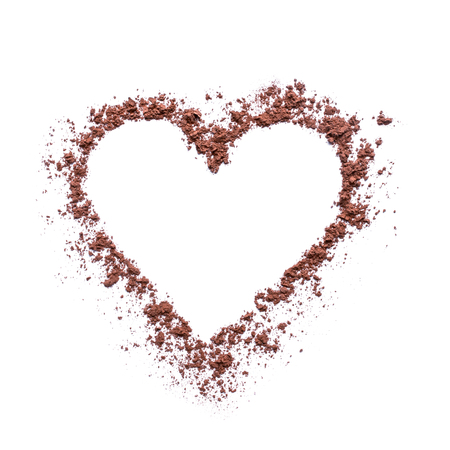 Cocoa powder or coffee in the shape of a heart. Concept- love, recipes, menus, preparation of drinks. Empty space for text or description. Isolated on white.