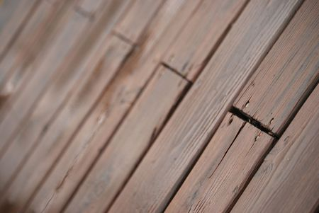 This is a photograph of deck boards taken after a rainy day in late March.  The deep colors and contrast drew my attention.  It was shot at an agle to add interest.   Stock fotó