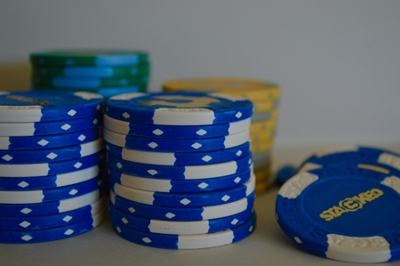 stack of poker chips on a white background Editorial