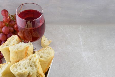 Golden Fresh Baked Bread and Delicious Red Wine Atop a Stone Background with Space for Text
