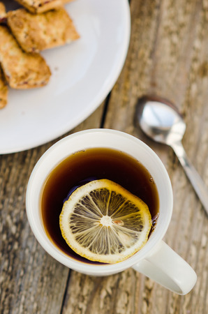 Cup of tea with lemon and cookies photo