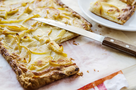 crust crusty: hot fresh flaky apple pie on a wooden table