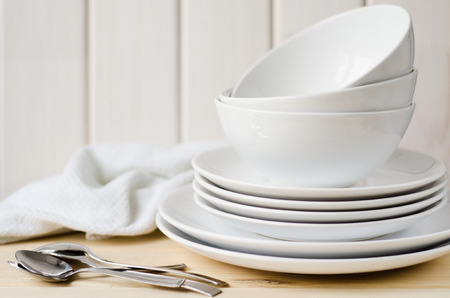 plate: white large and small plates and bowls on a light table