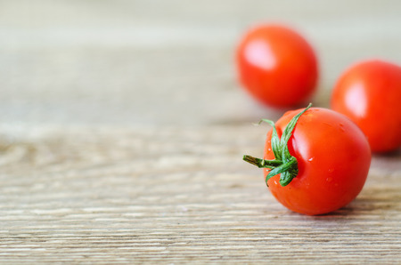 fresh red cherry tomatoes on a wooden table Stock fotó