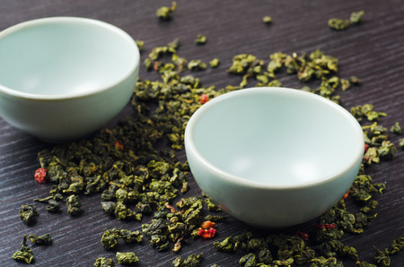 oolong: bowls with green oolong tea and strawberries